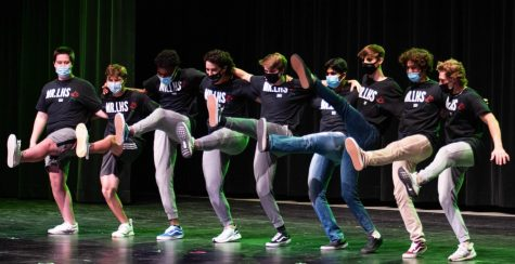 Mr. LHS contestants form a kickline during their performance.