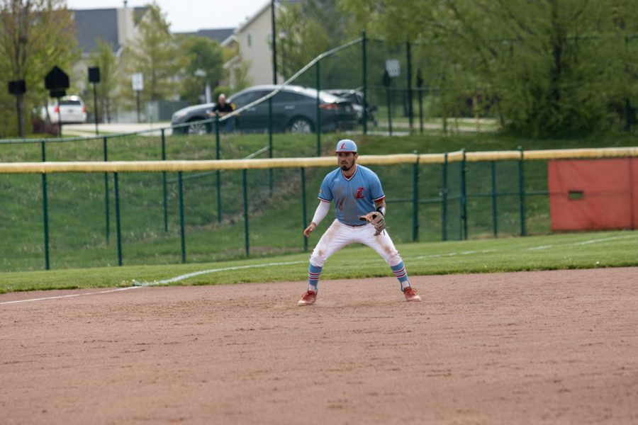 Senior infielder Kyle Bermudez gets into position on defense while waiting for the pitch to be delivered.