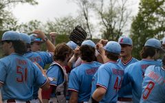 The varsity baseball team celebrates their victory on senior night.