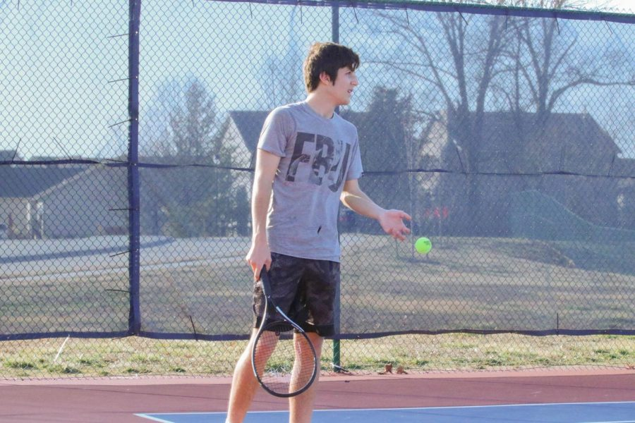 Sam Arrington prepares to serve a ball at practice early in the season