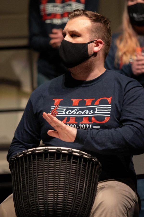 Mr. Datz, the incoming choir teaching, plays the djembe.