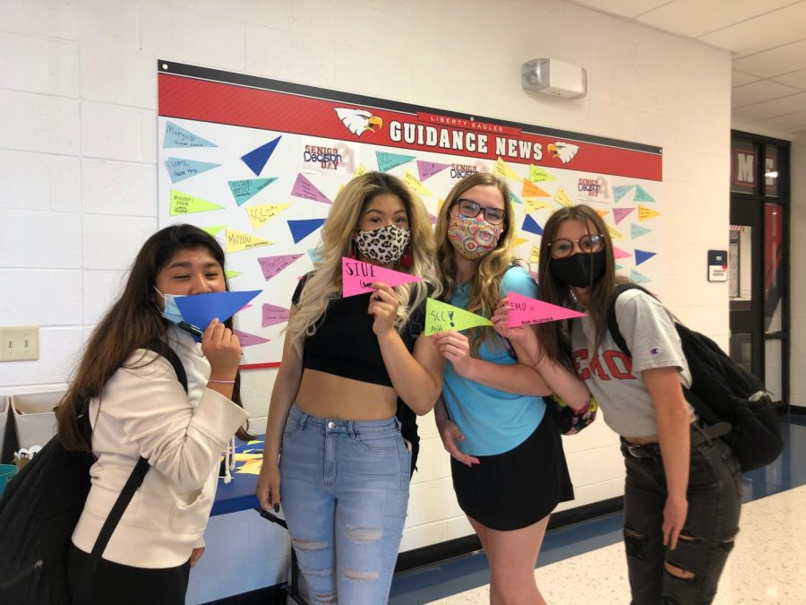 (left to right) Mila Lange, Gabby Travis, Ashley Twellman, and Abbie McCormick post their decisions on the board.