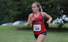 Ally Kruger runs in a cross country race in the fall at McNair Park. In April, Kruger broke a 30-year record at a track meet in Jefferson City and was also named the Gatorade cross country runner of the year in Missouri.