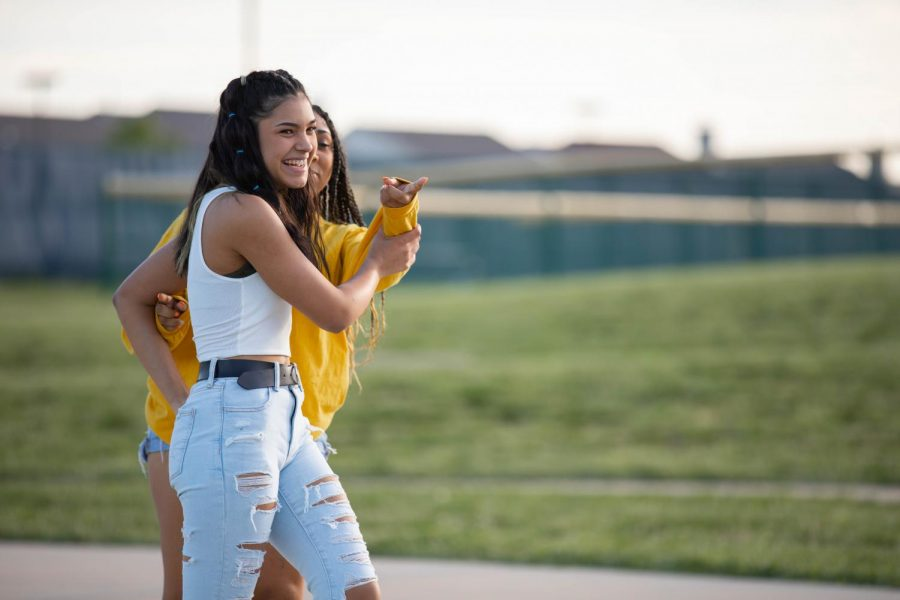 Vianca Malave (10) and Kira Radichel (10) having fun at the open field hosted by Diversity Club.
