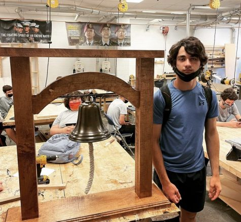 Sophomore Vito Signaigo poses with his recently created Liberty bell stand.
