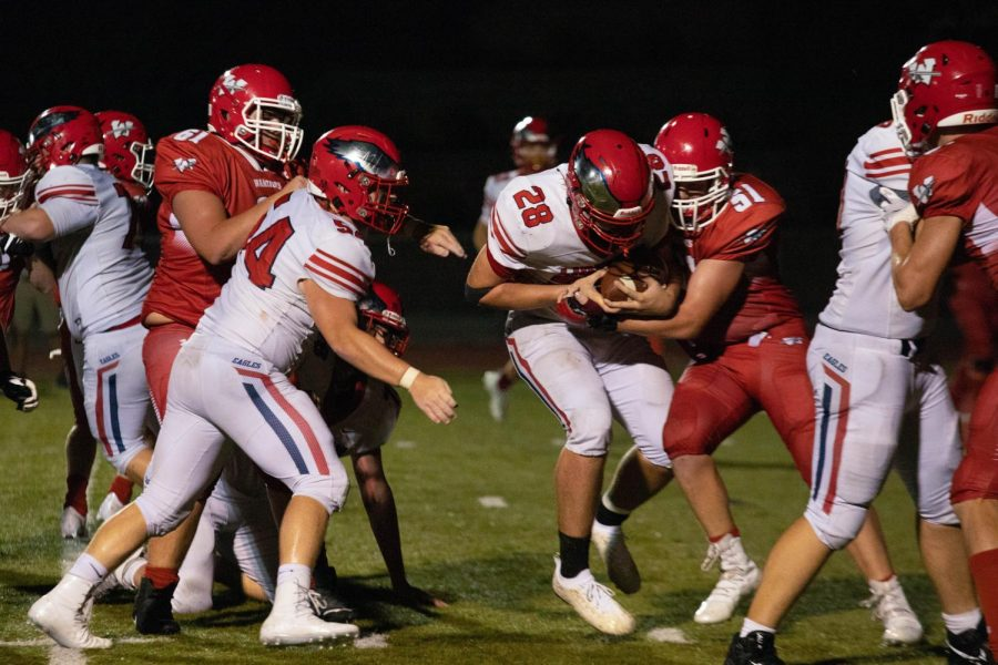 Ethan Weiler gains yardage on a running play in the fourth quarter against Warrenton. Weiler led the Eagles with 86 rushing yards.
