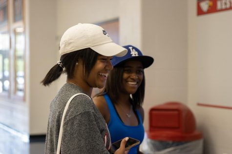 Charity Edney (left)(11) laughs with another student about Key Club.