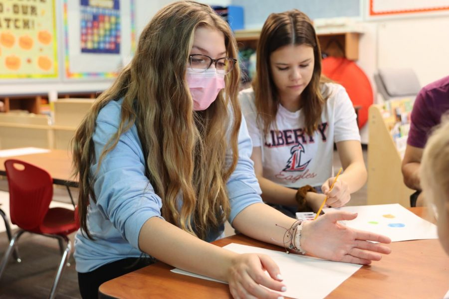Olivia Marshall and Hailey Buckley prep their activity for the first day of school