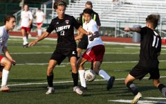 Schrader Ludwig (#12) and Carson Nolan (#11) attempt to keep possession of the ball.