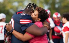 Kevin Lyles hugging his mother Nellie at Senior Night. KJ plans to continue playing football after graduation.