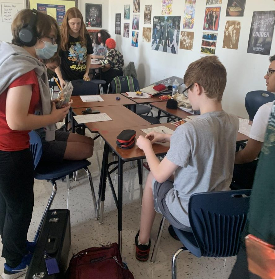 Members of the tabletop club meet in Mrs. T.O.s classroom.