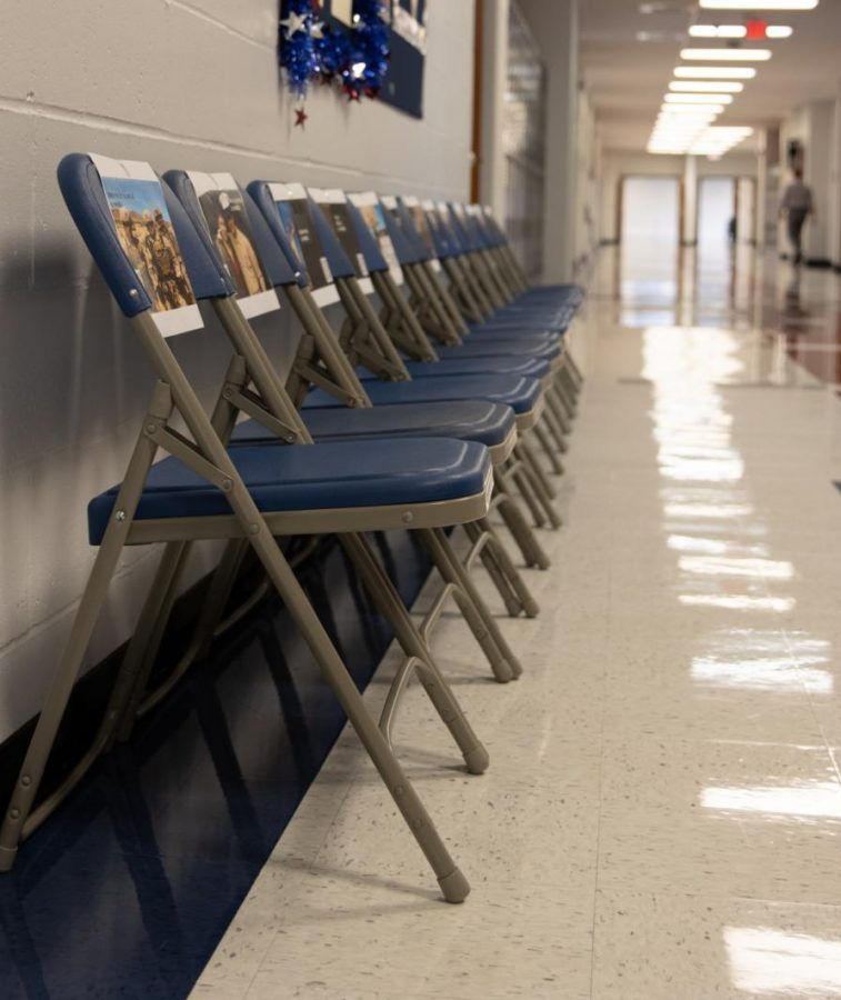 Teachers in 400 hallway set up 13 chairs for the fallen who died in Afghanistan.