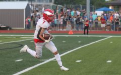 Sophomore Peyton Bertels ran the ball on a kick return against the Timberland Wolves.