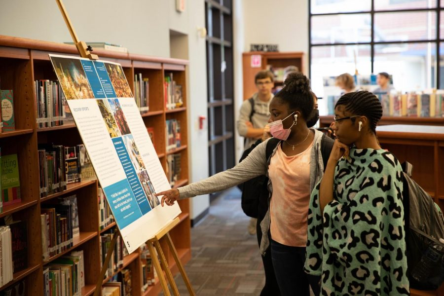 Students soak in the posters stationed around the library, courtesy of the 9/11 Memorial and Museum.