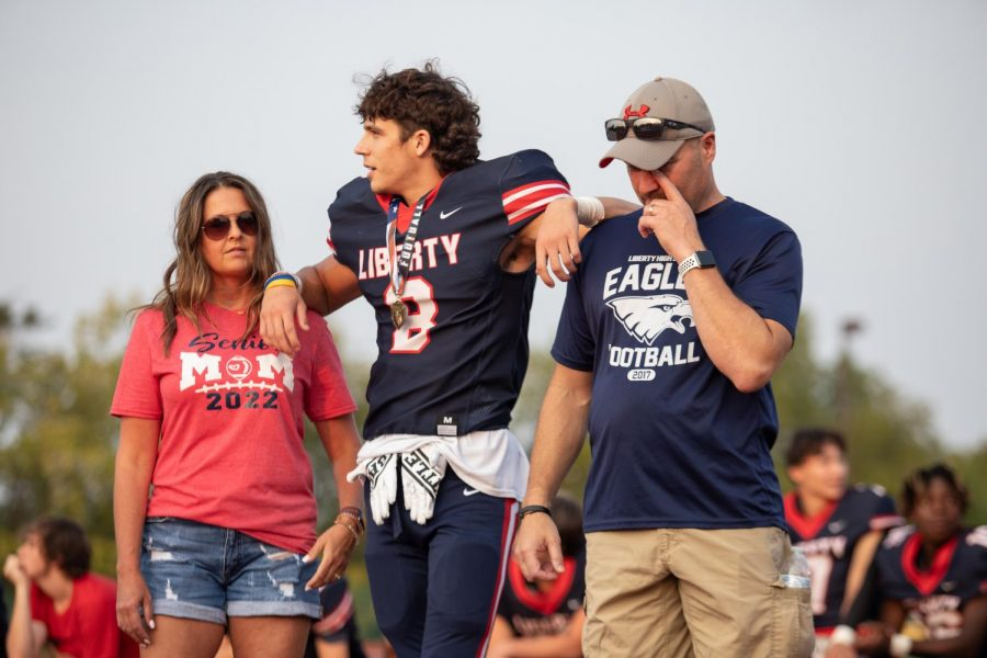 Senior Jacob Sorge watches as his team mates are escorted by their parents.