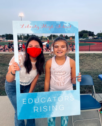 Educators Rising President Athena Widlacki (12) poses with a freshly painted Eagles fan.