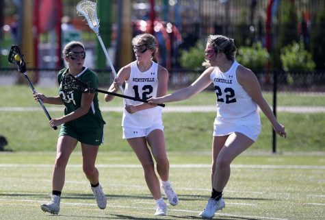 Wentzville Girls Lacrosse players playing defense during an intense game against Pattonville.