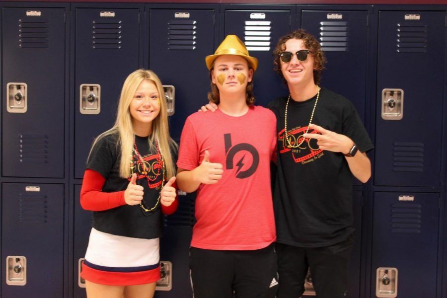 Anna Mecker, Colin Doniff, and Aiden Berry on Fridays spirit day, red, black, and gold.