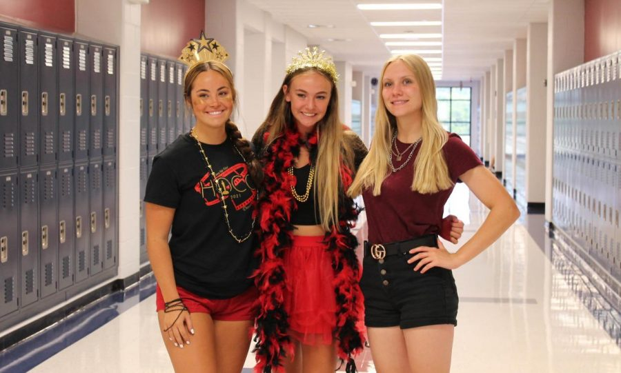 Molly Marino, Brooklyn Rudolph, and Lillia Clay the day of the homecoming game dressed up for spirit week in all red, black and gold.