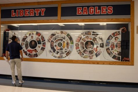 Mr. Glavin takes a look at the school mural at the entrance of the school.
