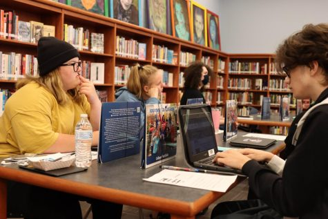 Students work on college application process in the library on Tuesday.