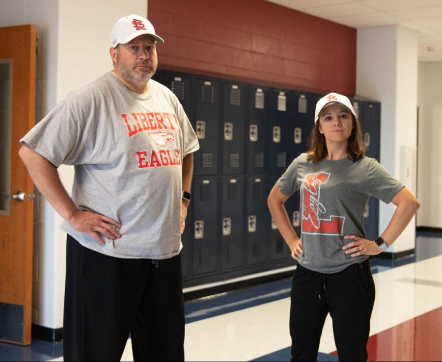 Mr. Bender and Mrs. Fedderson twin in gray Liberty shirts, black pants, and white Cardinals hats for Tuesday.