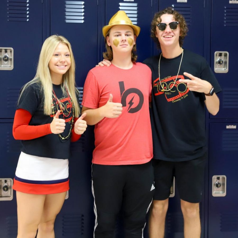 Anna Mecker, Colin Doniff and Aidan Berry in red,black, and gold for Friday.
