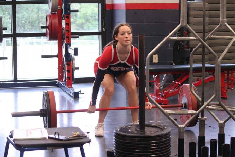 Junior Kyley Rowe is preparing to deadlift the barbell in the beginning phase of the clean progression.